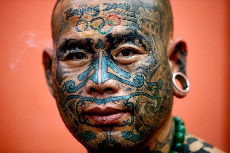 Любитель татуировок (7 фото)