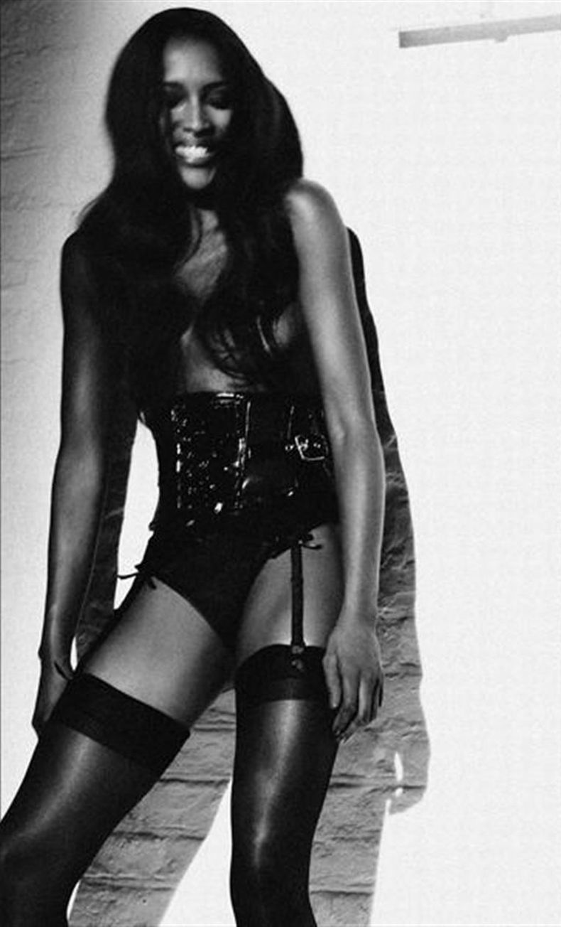 Naomi campbell poses topless for interview mag