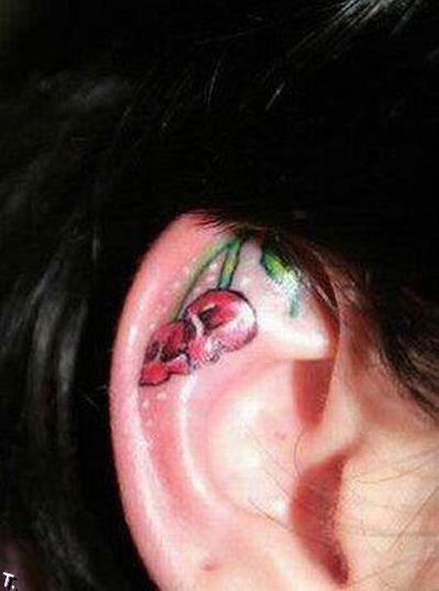 Татуировки в ушах (15 фото)