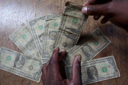 Отмывание денег по-зимбабвийски (5 фото)