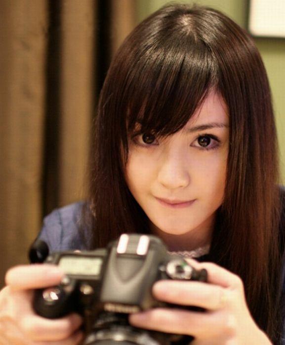 Симпатичные девушки с фотоаппаратами