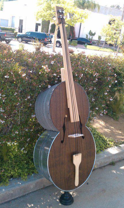 Музыкальный инструмент из корыта (6 фото)