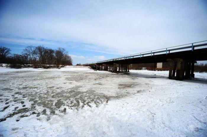 Приготовления к весеннему паводку в Приморье (13 фото + видео)