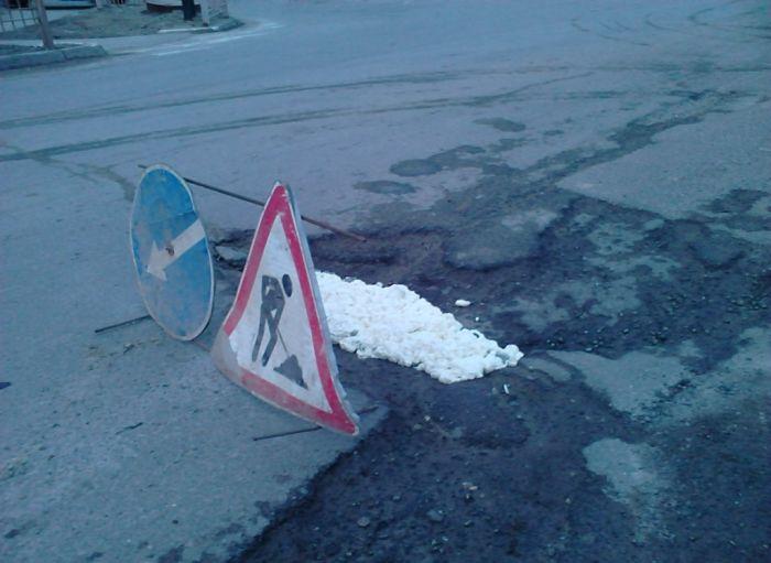 Технология ремонта дороги в Нефтеюганске (3 фото)