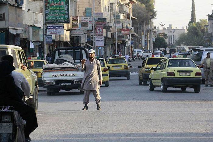 Столица «Исламского государства» в фото (26 фото)