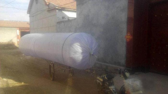 Китаянка нашла способ решить проблему нехватки газа для бытовых нужд (5 фото)