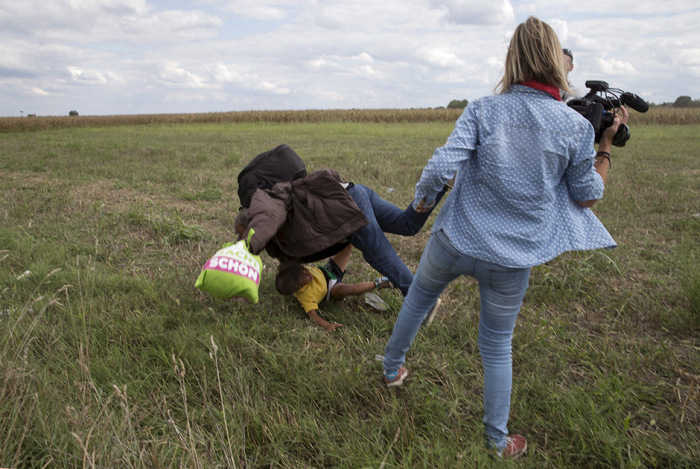 Истории появления самых драматичных снимков фотокорреспондентов Reuters за 2015 год (14 фото)