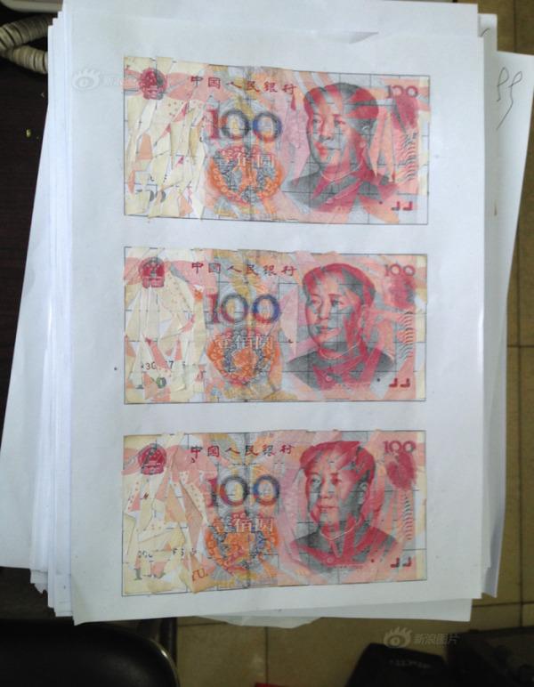 Семейная пара из Китая в течение трех месяцев склеивала измельченные купюры на сумму в 21 000 долларов  (3 фото)
