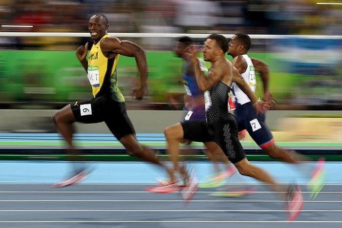 Усэйн Болт стал семикратным олимпийским чемпионом, выиграв «золото» в стометровке (3 фото)