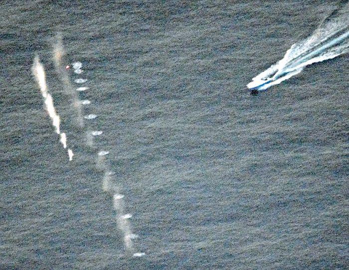 Выстрел снайпера остановил катер с кокаином на сумму более 50 млн долларов (3 фото)