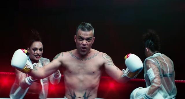 В новом клипе Робби Вильямс выходит на боксёрский ринг против самого себя