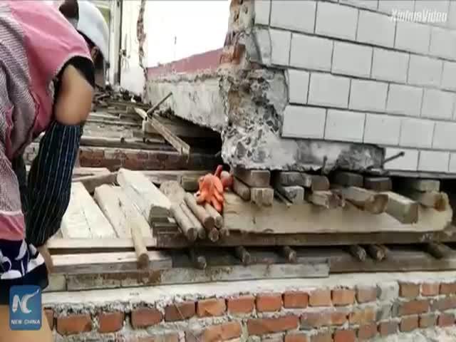 Перемещение здания в Китае