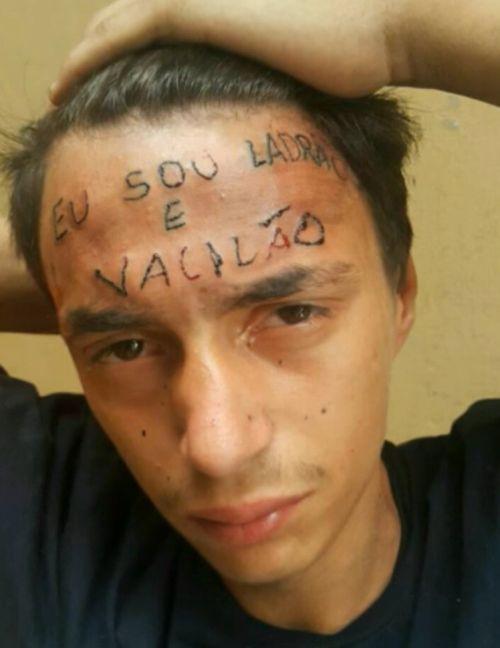 Вор с татуировкой «я вор и идиот» на лбу попался на краже (3 фото)