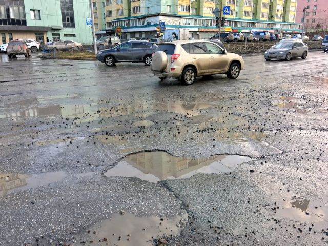 Дорожная яма стала одной из достопримечательностей Новосибирска на картах Google (7 фото)