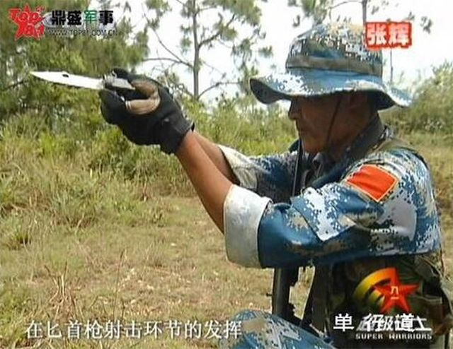 Китайский стреляющий нож QSB-91 (6 фото)