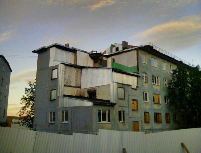 Сказочный дворец: восстановленный после взрыва газа жилой дом в Мурманске (2 фото)
