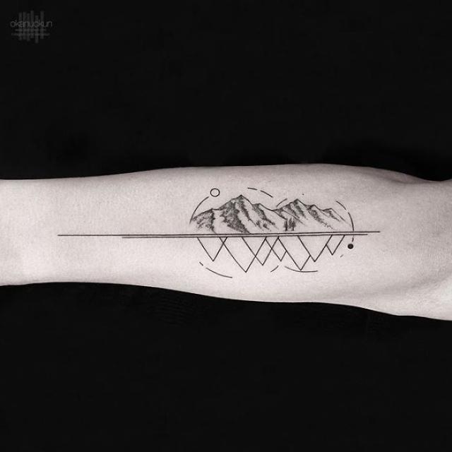 Необычные татуировки от турецкого мастера Окана Учуна (24 фото)