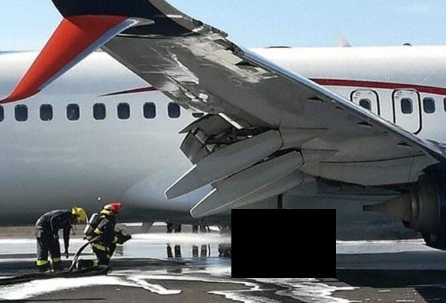 Необычное происшествие во время приземления пассажирского самолета (2 фото)