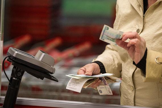 Россияне смогут снимать деньги в кассах супермаркетов