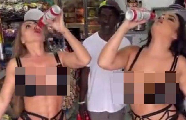 Девушки в нижнем белье шокировали покупателей в магазине, отобрав пиво у мужчины