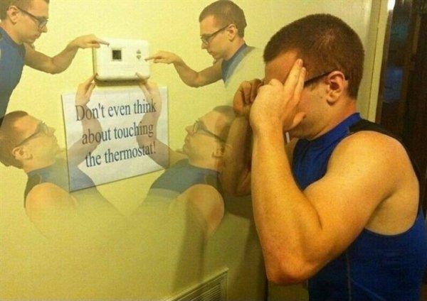 """Надпись на стене: """"Даже не думай о том, чтобы тронуть термостат"""""""