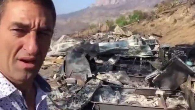Мужчина пришел на пепелище, оставшееся от его дома после пожара, и нашел своего выжившего кота