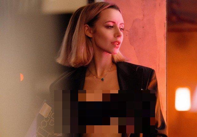 Наталья Османн в темном пиджаке и черном нижнем белье