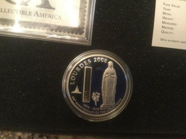 Монета с сосудом, наполненным святой водой. Один доллар республики Палау, 2008 год