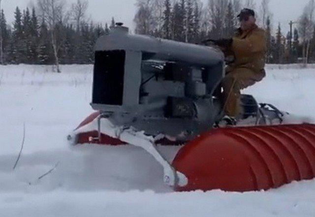 Как приспособить трактор к заснеженной местности