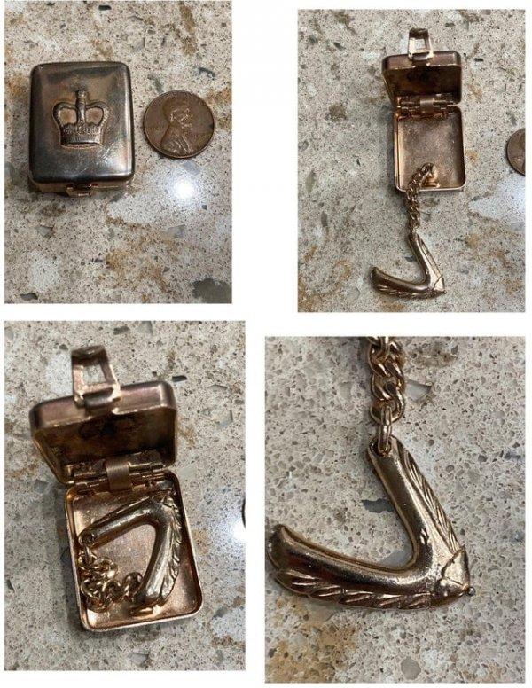 Необычная маленькая серебряная шкатулка с крылышком на цепочке внутри