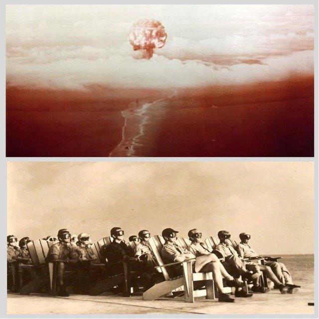 VIP наблюдатели на внутреннем дворике Офицерского Пляжного Клуба на острове Parry Island освещены взрывом 70-килотонной бомбы, взрыв которой был частью операции Operation Greenhouse, 8 апреля 1954 года