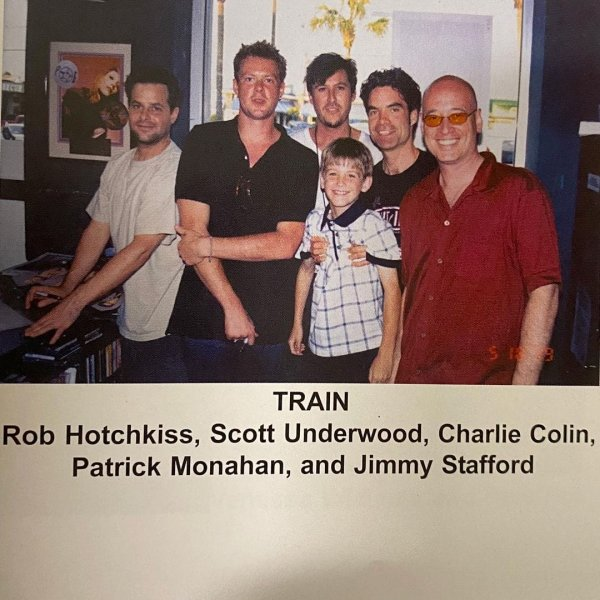 С группой Train