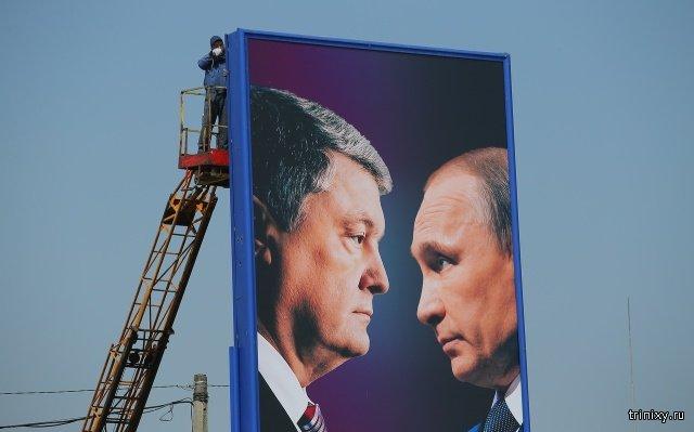 Букмекеры рассказали о шансах Петра Порошенко победить во втором туре выборов после появления плакатов с Путиным