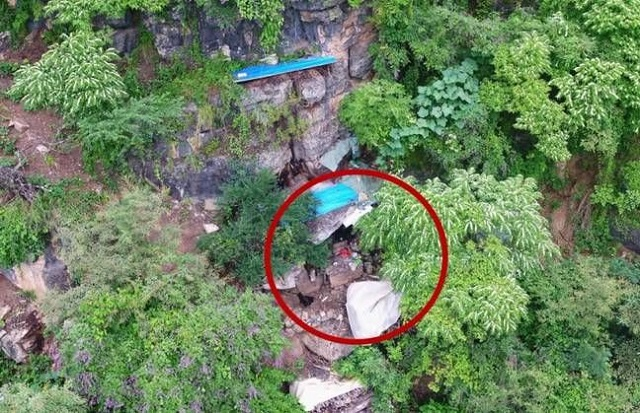 В Китае дроны нашли работорговца, который 17 лет прятался в горах (4 фото)