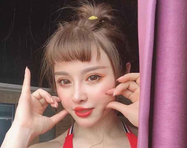 Юань Хэжун - девушка с кукольным личиком и грозным телосложением (20 фото)