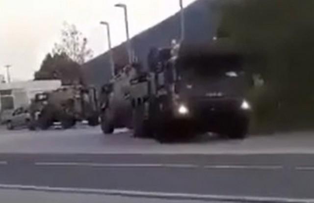 Тягач эвакуирует машину НАТО