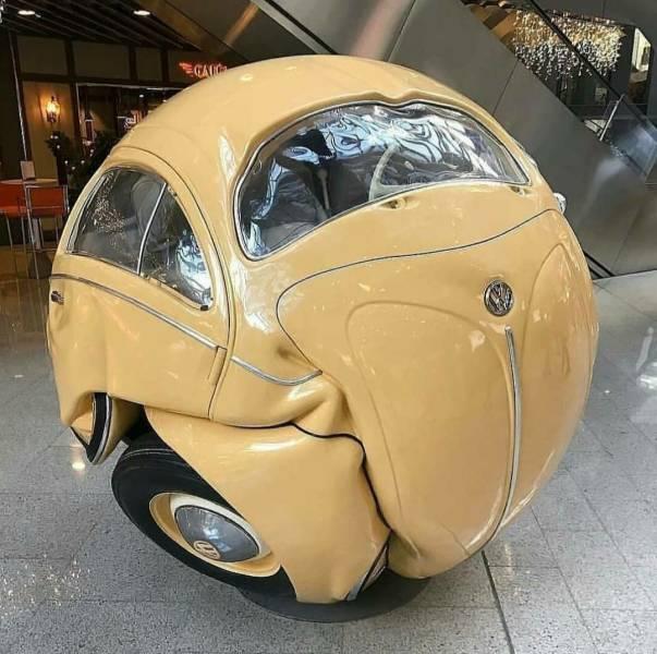 Скульптура шар из автомобиля