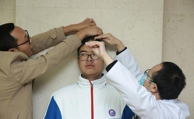 Рен Кей измеряет рост