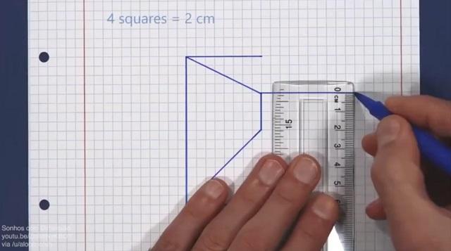 Рисует куб на бумаге