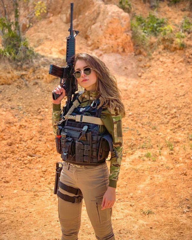 Габриэла Куэйроз с винтовкой